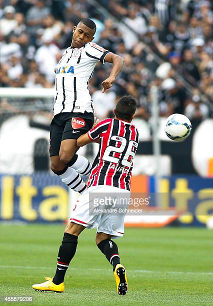 Auro of Sao Paulo and Malcom of Corinthians in action during the match between Corinthians and Sao Paulo for the Brazilian Series A 2014 at Arena...