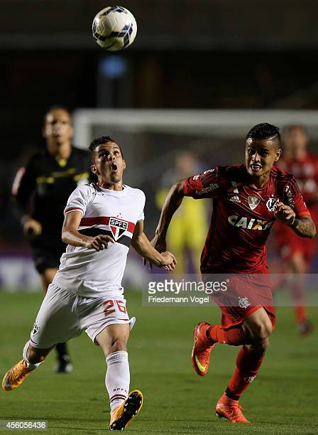 Auro of Sao Paulo fights for the ball with Everton of Flamengo during the match between Sao Paulo and Flamengo for the Brazilian Series A 2014 at...