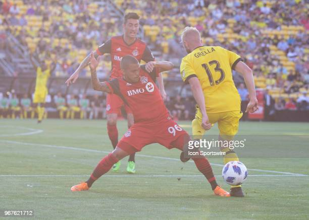Auro of Toronto FC takes the ball away from Mike Grella of Columbus Crew SC during the game between the Columbus Crew SC and the Toronto FC at MAPFRE...