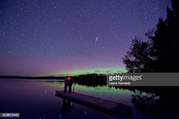 auroa borealis glows on the horizon in minnesota's superior national forest. - boundary waters canoe area stock pictures, royalty-free photos & images