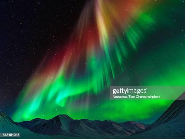 Auroara Borealis above Brooks Range mountain, Alaska, USA
