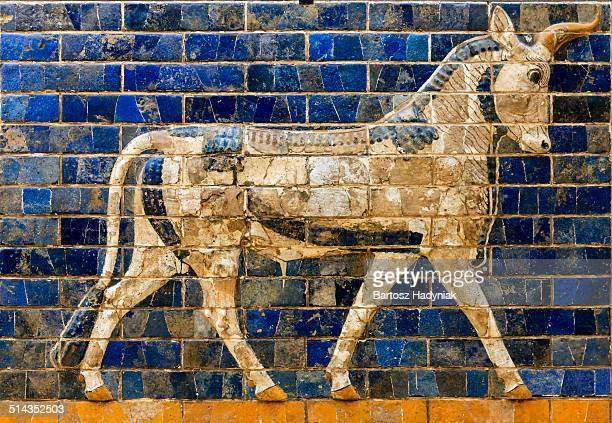 auroch on brick panel from way to ishtar gate - ishtar gate stock photos and pictures