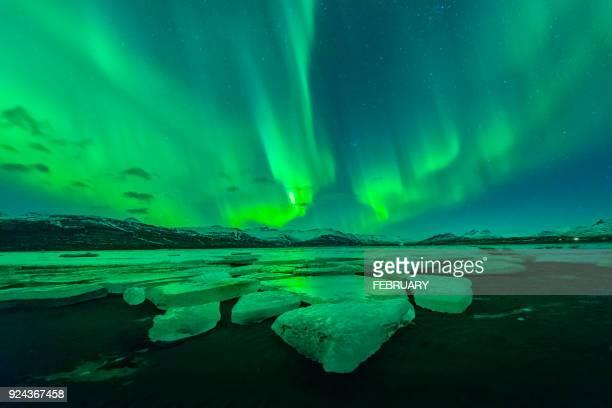 Aurora above big glacier at Iceland