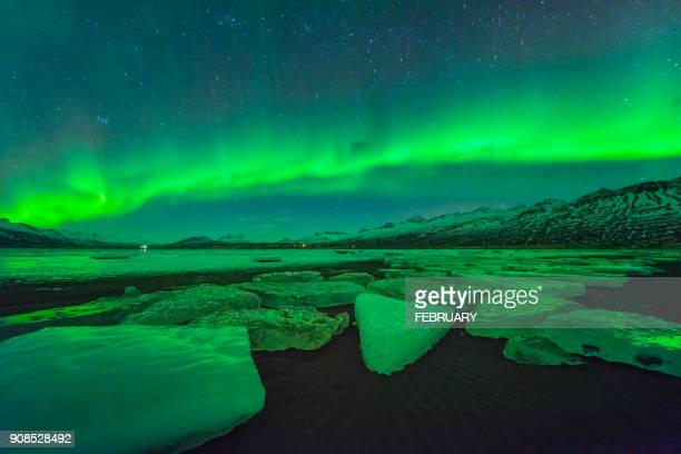 aurora above glacier at iceland - glacier lagoon stock photos and pictures