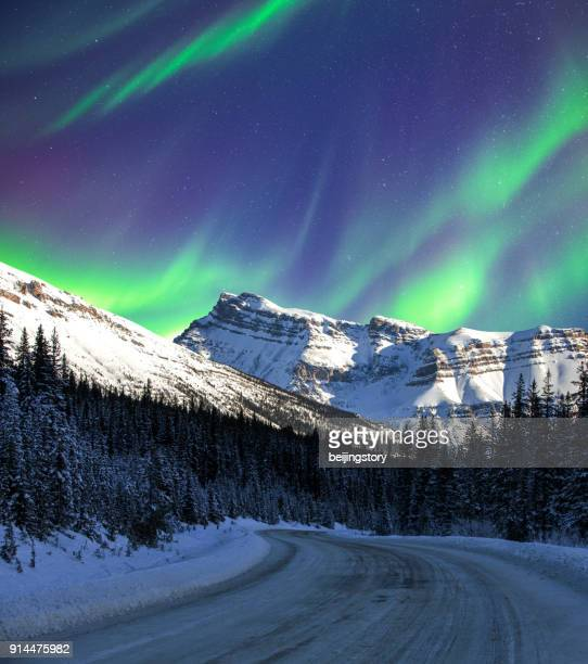 aurora and road - aurora borealis stock pictures, royalty-free photos & images