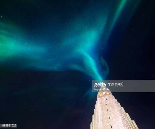 aurora borealis display over famous hallgrimskirkja church, reykjavik, iceland - impossiable stock pictures, royalty-free photos & images