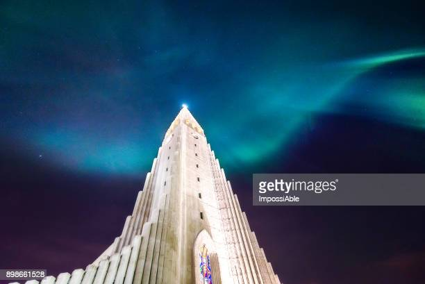 aurora borealis display over famous Hallgrimskirkja church, reykjavik, Iceland