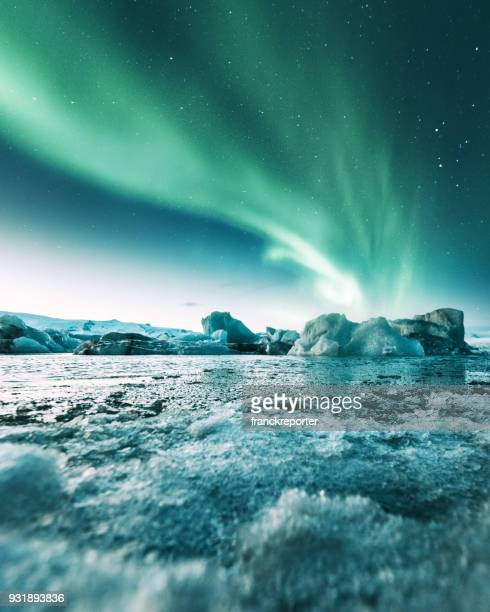 aurora borealis in iceland at jakulsarlon - north stock pictures, royalty-free photos & images