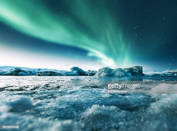 aurora borealis in iceland at jakulsarlon - aurora borealis stock pictures, royalty-free photos & images