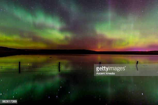 Aurora Borealis (Northern lights),in rural setting