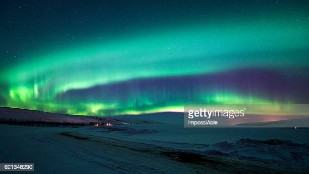aurora borealis in the night sky in iceland - husavik stock photos and pictures