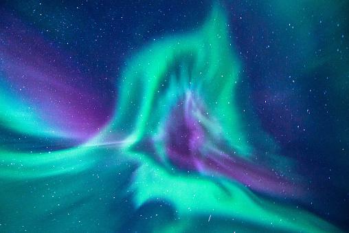 aurora borealis looks like phoenix display directly above the head in Iceland - gettyimageskorea