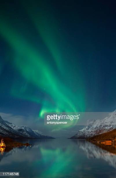 aurora borealis near tromsø, arctic norway. - finland stock pictures, royalty-free photos & images
