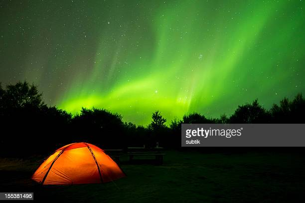 aurora borealis on iceland and a camping tent - aurora australis stock pictures, royalty-free photos & images