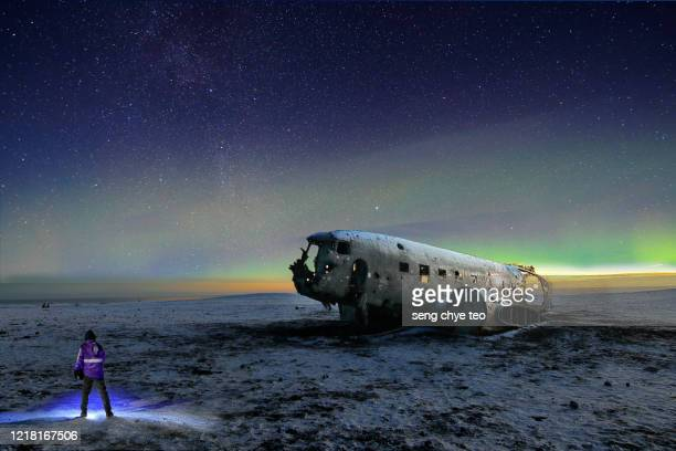 aurora borealis or northern lights, iceland - airplane crash stock pictures, royalty-free photos & images