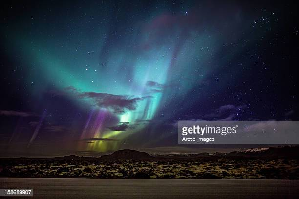 aurora borealis or northern lights, iceland - dramatic sky stock pictures, royalty-free photos & images