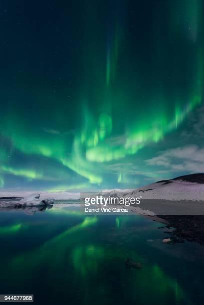 aurora borealis or northern lights, iceland - バトナ氷河 ストックフォトと画像