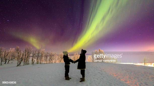 aurora borealis or northern lights, kiruna, sweden - swedish lapland stock photos and pictures