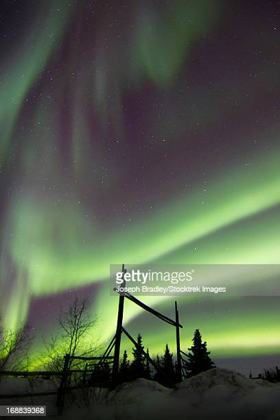 Aurora Borealis over a ranch, Whitehorse, Yukon, Canada.