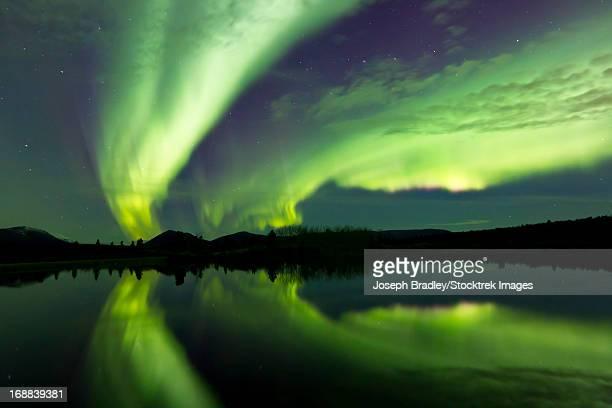 Aurora Borealis over Fish lake, Whitehorse, Yukon, Canada.