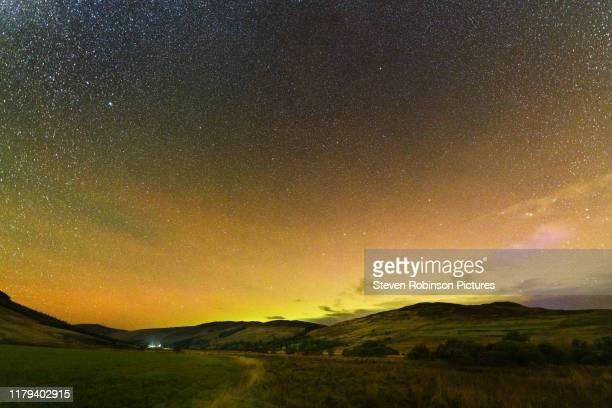 aurora borealis over glen quaich - space exploration stock pictures, royalty-free photos & images