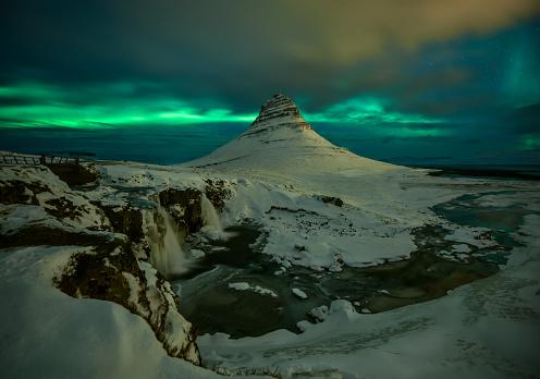 Aurora Borealis over Kirkjufell in Iceland. - gettyimageskorea