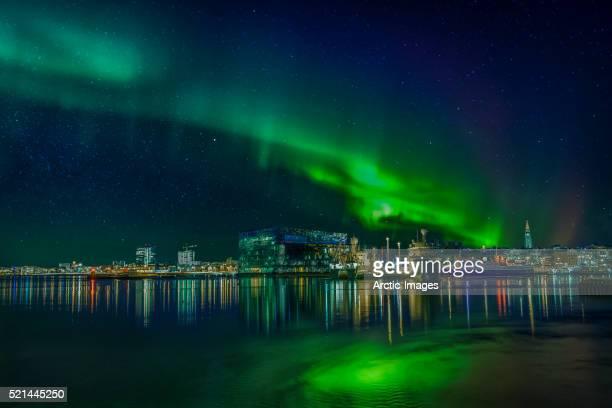 aurora borealis over reykjavik, iceland - reykjavik stock pictures, royalty-free photos & images