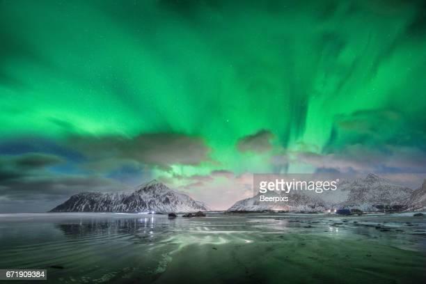 Aurora borealis over Skagsanden beach in Lofoten islands, Norway.
