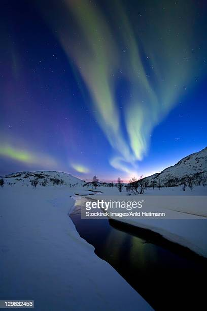 Aurora Borealis over Skittendalen Valley, Troms County, Norway.