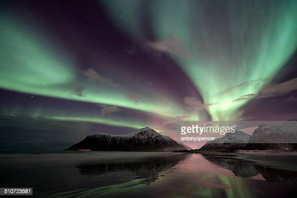 aurora borealis over the Lofoten Island of Flakstadøya, Arctic Norway
