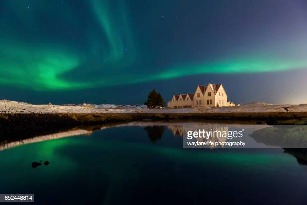 aurora borealis over the sky in winter - reykjavik stock pictures, royalty-free photos & images