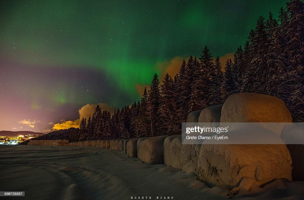 6cd4ee28c Aurora Borealis Over Wrapped Hay Bales In Snow Covered Field Stock ...