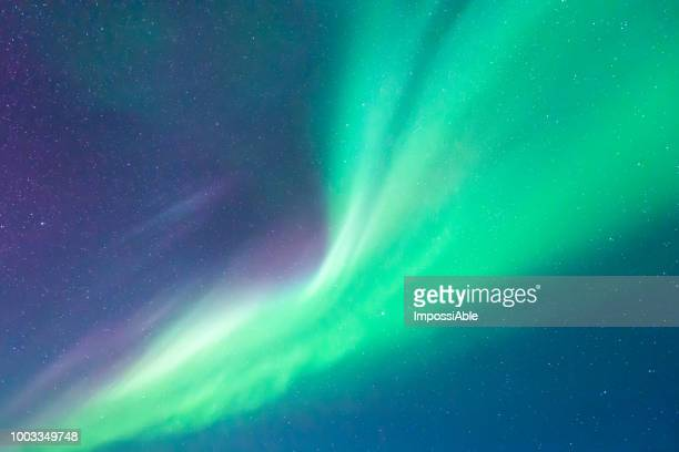 aurora borealis strong light shining bright in iceland - aurora polaris stock pictures, royalty-free photos & images