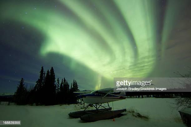 Aurora Borealis with float plane, Whitehorse, Yukon, Canada.