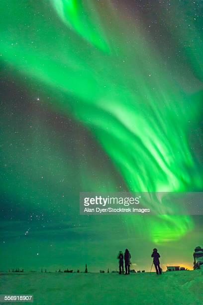 Aurora borealis with Taurus and Orion over Churchill, Manitoba, Canada.