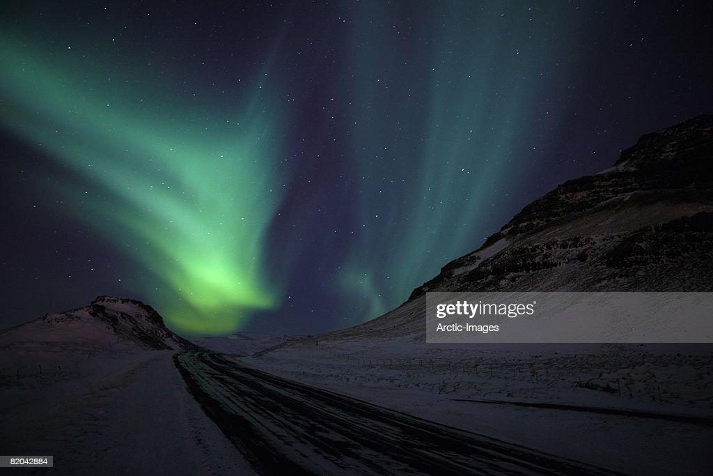 Aurora Borealis with Winter Road, Iceland : Stock Photo