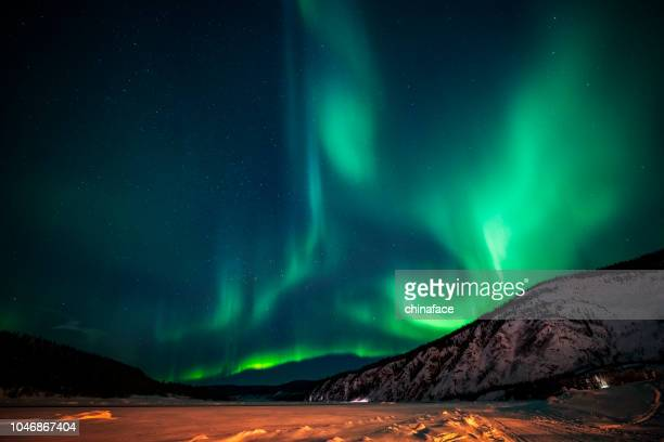 aurora borealis,yukon territory,canada - north stock pictures, royalty-free photos & images