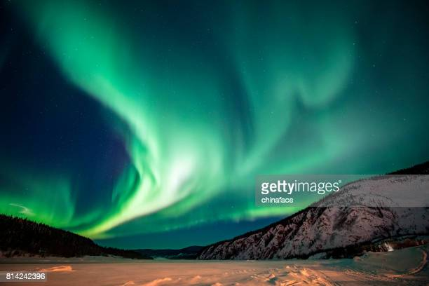 aurora borealis,yukon territory,canada - canada stock pictures, royalty-free photos & images
