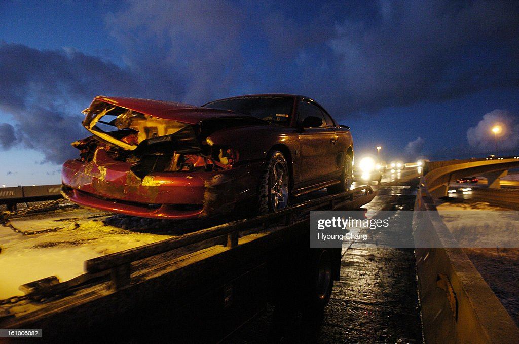 Aurora CO, January 16, 2006 - A ford mustang is moved from a