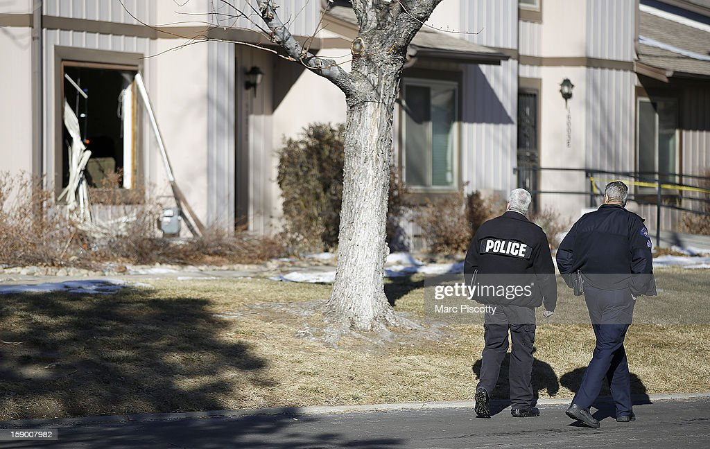 Aurora, Colorado Police walk by the scene where four people were killed Saturday morning including the gunman who held police at bay for several hours at the complex January 5, 2013 in Aurora, Colorado. Aurora SWAT team members shot a gunman after he went to a second-floor window and fired at police. The gunman also allegedly fatally shot two men and a woman that he had taken hostage. One woman managed to escape from an upstairs back window, ran from the home and called police just before 3 a.m., said Cassidee Carlson, Aurora police spokeswoman.