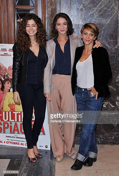R Aurora Cossio Nicole Grimaudo and Paola Minaccioni attend a photocall for 'All'Ultima Spiaggia' on October 3 2012 in Milan Italy