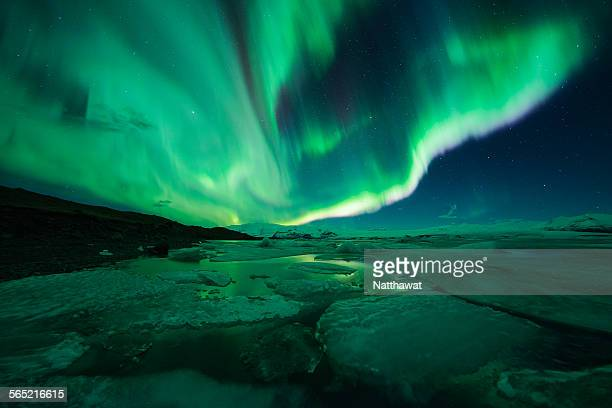 aurora display over the glacier lagoon jokulsarlon - solar flare stock pictures, royalty-free photos & images