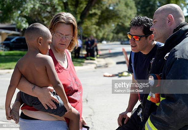 Aurora firefighters talk to Susan Nieves and her grandson Chassyon about the fire that started in Nieves's bottom unit apartment A twoalarm fire at...