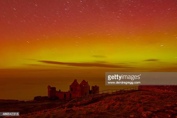 aurora from dunluce castle portrush - northern ireland stock photos and pictures