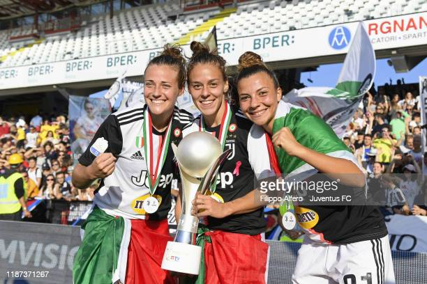 Aurora Galli Lisa Boattin and Arianna Caruso celebrate the victory at the end of the Italian Supercup match between Juventus Women and Fiorentina...