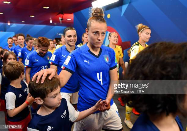 Aurora Galli of Italy walks out with a mascot prior to the 2019 FIFA Women's World Cup France group C match between Australia and Italy at Stade du...