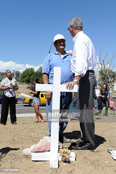 Aurora Mayor Steve Hogan greets Greg Zanis from Aurora Ill who built and placed 12 white crosses in memoriam of the victims of Friday's shooting Greg...