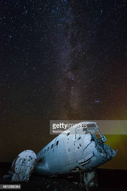 Aurora milky way galaxy stars over plane crash beach Iceland
