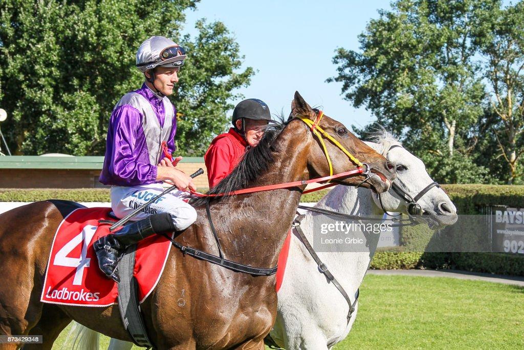 Aurora Miss ridden by Clayton Douglas returns after winning the Mornington Car & Tyre Services Handicap at Mornington Racecourse on November 13, 2017 in Mornington, Australia.
