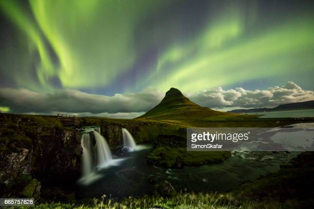 Aurora over Kirkjufell and waterfall at night